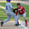 Beverly:<br /> Boxford's, Peter Bankes, first baseman, gets the throw trying to pick off Danvers American's Jordon DeDonato as he gets safely back to first in the Boxford vs Danvers American District 15 Little League all-star game at Harry Ball field.<br /> Photo by Ken Yuszkus/Salem News, Monday, July 11, 2011.