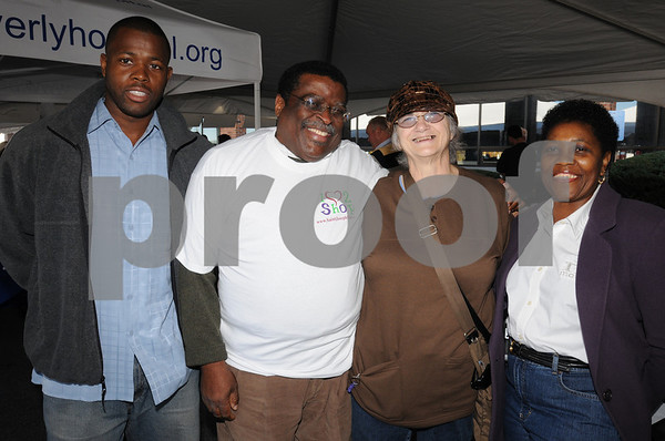 Danvers:<br /> From left, Jeff Smith of Lynn, James Broadnax of Salem, Veann Campbell of Salem and the Salem Food Pantry, and Mary Sheriff of Lynn, at the food drive. Sen. Fred Berry organized a day-long family festival to get donations for 6 local food pantries in Salem, Beverly, Peabody and Danvers.<br /> Photo by Ken Yuszkus/Salem News, Sunday October 25, 2009.