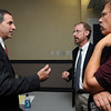 Beverly:<br /> From left, Beverly Democratic state representative candidates Jerry Parisella and Scott Houseman, speak with Beverly resident, Tony Toledo, just before the start of the Beverly Democratic state representative debate between Jerry Parisella and Scott Houseman at the Beverly Public Library.<br /> Photo by Ken Yuszkus/Salem News, Tuesday,  September 7, 2010.