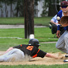 Beverly:<br /> Beverly's Alex Toomey gets back safe to first base as Belmont's John Dillon gets the throw to pick him off during the Belmont at Beverly High state tournament baseball game.<br /> Photo by Ken Yuszkus/Salem News, Thursday, May 31, 2012.