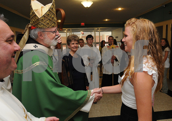 Peabody:<br /> Cardinal Sean OÕMalley, Archbishop of Boston, greets Stephanie Morrison of Beverly, who is a senior at Bishop Fenwick high School, just after the ceremonies in the auditorium. The Archbishop spoke at the 50th Anniversary Liturgy at Bishop Fenwick High School.<br /> Photo by Ken Yuszkus/Salem News, Sunday, September 13, 2009.