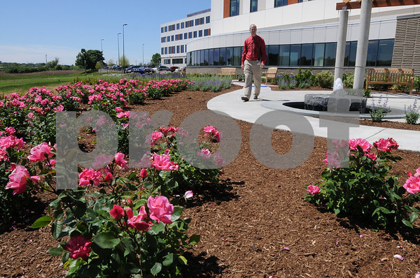 Danvers:<br /> Kevin Ronningen of North Shore Medical Center walks the circular path in the new garden area outdoors near the North Shore Medical Center Cancer Center.<br /> Photo by Ken Yuszkus/Salem News, Monday, June 1, 2009.