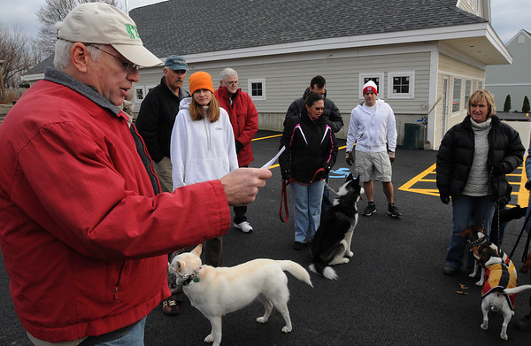 Danvers:<br /> Mark Lettich says a few words to the assembled people in the parking lot of the former Danversport Bakery before heading out for their walk on the 3-year anniversary of the explosion.<br /> Photo by Ken Yuszkus/Salem News, Sunday November 22, 2009.