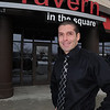 Salem:<br /> Stephen DeSousa, co-owner and director of operations at the Tavern in the Square, stands in front of the restaurant.<br /> Photo by Ken Yuszkus/Salem News, Friday, January 8, 2010.