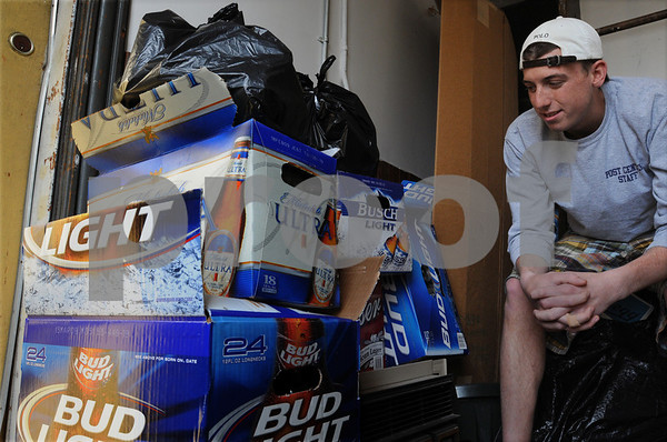 Beverly:<br /> Endicott College senior Matt Atkinson looks toward the trash generated from a recent party at his apartment. Matt said he understands why the city plans to crack down on off-campus parties.<br /> Photo by Ken Yuszkus/Salem News, Friday, April 10, 2009.