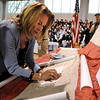 Danvers:<br /> Mary Ferguson is the first to sew stiches in the National 9/11 Flag at St. John's Prep during the ceremony Thursday morning. She lost her husband, George Ferguson, on 9/11. George was a third generation graduate of the school. Mary had suggested that St. John's Prep hold the ceremony at the school.<br /> Photo by Ken Yuszkus/Salem News, Thursday, March 24, 2011.