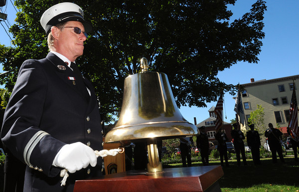 Marblehead:<br /> Fire Captain Michael Porter rings the fire bell at the remembrance ceremony to commemorate the 11-year anniversary of the September 11th terrorist attacks. The ceremony was held at Memorial Park.<br /> Photo by Ken Yuszkus/The Salem News, Tuesday, September 11, 2012.