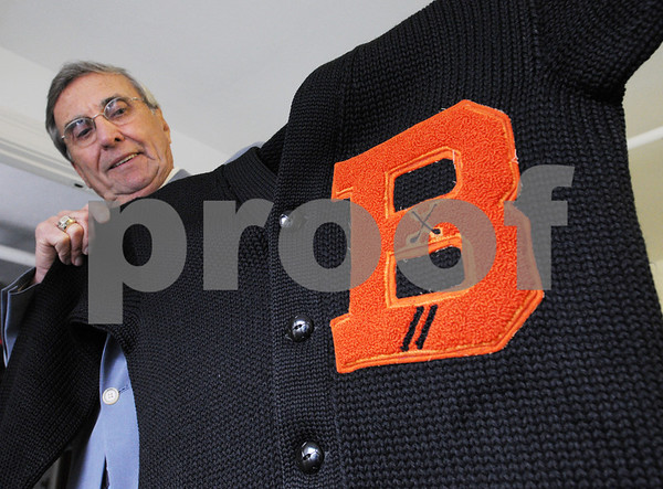 Peabody:<br /> Paul Kelley, Sr., holds up his 1949 Beverly High letterman sweater he received for helping the Beverly High School golf team win its first ever state title.<br /> Photo by Ken Yuszkus/Salem News, Tuesday, June 9, 2009.