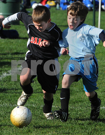 Peabody:<br /> John Mahoney of the Salem Eagles,left, drives the ball down field with Aidan O'Brien of the Swampscott Blue Thunder, by his side during a U-10 game at the Columbus Day Youth Soccer Tournament.<br /> Photo by Ken Yuszkus/Salem News, Sunday October11, 2009.