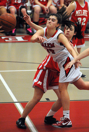 Salem:<br /> Salem's Rachel Zipper passes the ball near her net during the Melose at Salem High girls basketball state tournament game.<br /> Photo by Ken Yuszkus/Salem News, Tuesday,  February 28, 2012.