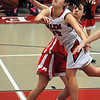 Salem:<br /> Salem's Rachel Zipper passes the ball near her net during the Melose at Salem High girls basketball state tournament game.<br /> Photo by Ken Yuszkus/Salem News, Tuesday,  February 28, 2012.