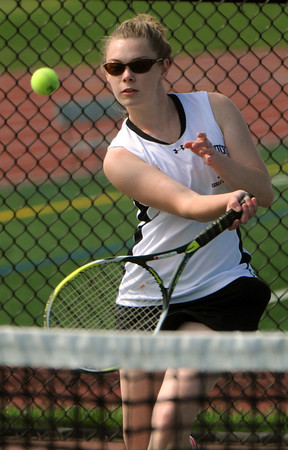 Peabody:<br /> Bishop Fenwick's Meredith Maguire returns the ball during her singles match at the North Reading at Bishop Fenwick girls state tennis tournament playoff match.<br /> Photo by Ken Yuszkus/Salem News, Friday, June1, 2012.