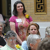 Boston:<br /> Julie DeSilva of Beverly, stands as she is recognized during the Ninth Annual Unsung Heroines of Massachusetts program at the state house.<br /> Photo by Ken Yuszkus/Salem News, Wednesday, May 16, 2012.