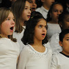 Salem:<br /> From left, Helena Connelly, Sherley Ramos, and Daniel Zepeda sing during the Bentley Chorus Winter Concert at Bentley Elementary School in Salem on Tuesday night.<br /> Photo by Ken Yuszkus/Salem News, Tuesday,  December 7, 2010.