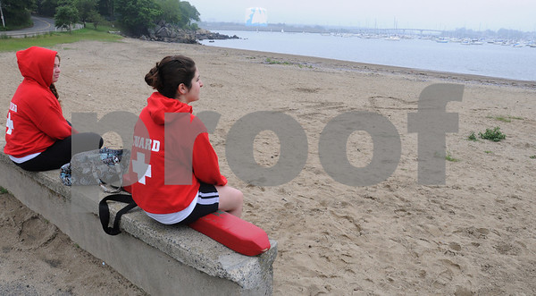 Salem:<br /> Lifeguards Mariel Marfongelli, left, and Andrea Brasileiro, wait for the people to arrive at Dead Horse Beach on another the gray morning.<br /> Photo by Ken Yuszkus/Salem News, Tuesday, June 30, 2009.