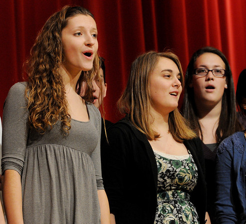 Salem:<br /> From left, Catherine Majeski, Emily Kent, and Allie LaMonica, some of the members of the Salem High School's WitchPitch, sing for the AARP Chapter 2454 meeting in the Salem High School auditorium on Friday afternoon.<br /> Photo by Ken Yuszkus/Salem News, Friday, January 7, 2011.