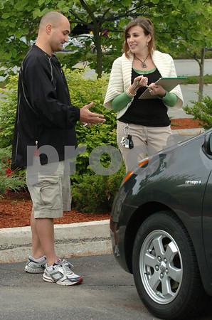 Beverly:<br /> Matt Herring, left, speaks to Andrea Fox about how grill blocks work on his car. He teaches super commuter driving classes.<br /> Photo by Ken Yuszkus/Salem News, Thursday, June 18, 2009.