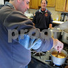 Peabody:<br /> Lt. Bob Caruso, right, has firefighter Tony Zuppio help out by frying some onions. Bob is cooking up his specialty, chicken parmesan. He has been cooking at Peabody Fire Department for 30 years.<br /> Photo by Ken Yuszkus/Salem News, Tuesday December 9, 2008.