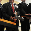 Beverly:<br /> William Scanlon, Jr., Beverly mayor, cuts the ribbon during the ribbon cutting ceremony for the new Beverly High School on Friday morning. To the right is Sean Gallagher, Beverly High School principal.<br /> Photo by Ken Yuszkus/Salem News,  Friday,  November 19, 2010.