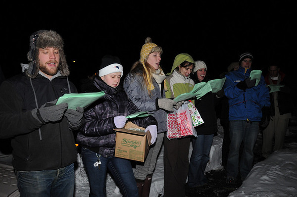 Beverly:<br /> From left, Jeremy Puz, of Beverly, Marissa Dumond, of Beverly, Leslie Jamison, of Topsfield, and Sara DeBaere, of Beverly, sing carols. Besides, Christmas carols, gifts were given out by the group walking in the Gloucester Crossing neighborhood.<br /> Photo by Ken Yuszkus/Salem News, Tuesday, December 22, 2009.