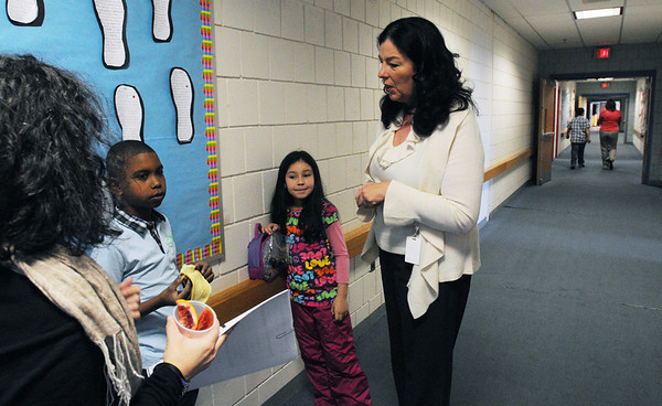 Salem:<br /> Principal Renata McFarland, right, speaks with newcomer students Michael Marte and Emilley Pinho with their teacher Marta Garcia in the hallway at the Bentley Elementary School during her morning rounds at the school.<br /> Photo by Ken Yuszkus/Salem News, Wednesday, January 18, 2012.