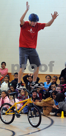 Salem:<br /> Chris Poulos, former Bicycle Stunt World Champion, does a stunt at  the Bowditch School while demostrating stunts and speaking to students about character building and bullying.<br /> Photo by Ken Yuszkus/Salem News, Thursday, October 23, 2008.