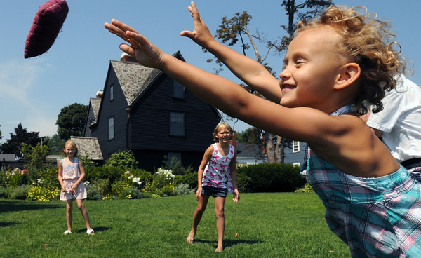Salem:<br /> Izzie Vance, 5, throws a bean bag called the fox toward her mother while playing a 400 year old game of fox and squirrel during the Lawn games at the House of 7 Gables as part of Heritage Days. Her sisters Charly, left, 6, and Annabelle, 9, center, are also playing the game. They are from Hope, New Jersey.<br /> Photo by Ken Yuszkus/The Salem News, Thursday, August 9, 2012.