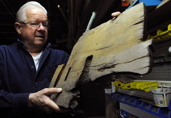 "Beverly:<br /> Norman ""Dugie"" Russell dove on the sunken wreck of the U.S.S. New Hampshire off Singing Beach in Manchester. He is holding a piece of wood from the wreck that he will fashion into pieces of art which he sells.<br /> Photo by Ken Yuszkus/Salem News, Friday,  April 8, 2010."