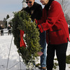 Hamilton:<br /> Joanne Patton lays a wreath at Patton Park with the help of John Williams, president of Wreaths Across America. The Wreaths Across America convoy stopped in Hamilton on it's way to Arlington National Cemetery.<br /> Photo by Ken Yuszkus/Salem News, Monday, Decmber 7, 2009.