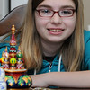 Salem:<br /> Bridget Ayers, 12-year-old Salem resident, was so inspired by a local blogger that she raised money and recently traveled to Siberia for 2 weeks to volunteer at an orphanage. In front of her are a few souvenirs from Moscow.<br /> Photo by Ken Yuszkus/Salem News, Thursday, June 23, 2011.