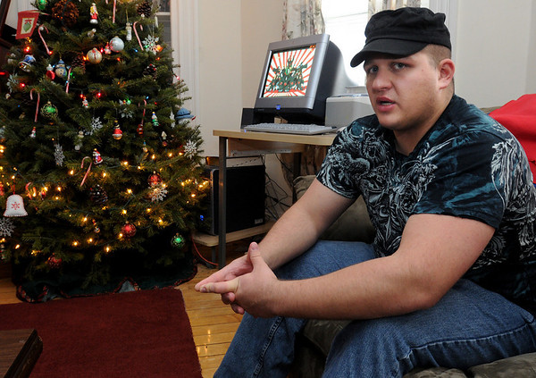 Danvers:<br /> Spc. Nathan Davis, 22, of Danvers, is about to head off to Afghanistan with the Mass. National Guard. He talks about his upcoming tour of duty in his livingroom.<br /> Photo by Ken Yuszkus/Salem News, Thursday, December 31, 2009.