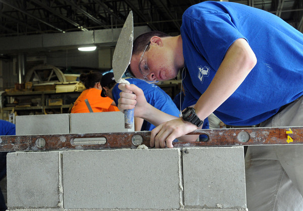 Middleton:<br /> Sean Mullin of Salem and from the North Shore Technical High School, levels the blocks as he builds a composite wall during the Trowel Trades Competition at the school. <br /> Photo by Ken Yuszkus/Salem News, Wednesday, May 23, 2012.