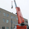 Danvers:<br /> Solar panels are lifted by crane to the rooftop of North Shore Community College's Berry Building.<br /> Photo by Ken Yuszkus/Salem News, Monday, March 21, 2011.