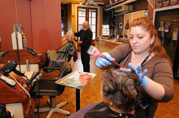Salem:<br /> Alex Panos, left, and Melissa Penta work on clients at the Alex and Co. hair salon where Melissa has an art show.<br /> Photo by Ken Yuszkus/Salem News, Tuesday November 24, 2009.