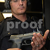 Salem:<br /> Brian St.Pierre, Salem patrolman, displays his new Smith & Wesson M+P 40 handgun which is a 40 caliber handgun. After 20 years using old guns, the Salem Police Department has bought 136 new handguns. They are starting to train with them now. <br /> Photo by Ken Yuszkus/Salem News, Wednesday September 17, 2008.