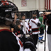 Salem:<br /> Coach Emily Hudak instructs the players during the Marblehead High School girls hockey youth clinic at Salem State University. The players worked with local female youths on Thursday evening.<br /> Photo by Ken Yuszkus/Salem News, Thursday, February 24, 2011.