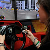 Beverly:<br /> Haley Sciolo text messages while using the driving simulator.<br /> Photo by Ken Yuszkus/Salem News, Monday, July 11, 2011.