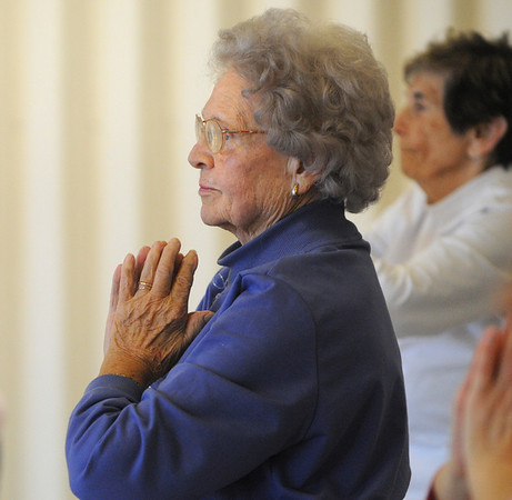 Danvers:<br /> Jean Lewis participates in the chair yoga class at the Danvers Council on Aging on Monday afternoon.<br /> Photo by Ken Yuszkus/Salem News, Monday, January 9, 2012.