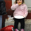 Wenham:<br /> Jaime Joyce, 4, of Ipswich, munches on her slice of pizza while sitting with her new fire helmet at the Wenham Fire department open house on Wednesday evening.<br /> Photo by Ken Yuszkus/Salem News, Wednesday, October 12, 2011.