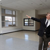 Beverly:<br /> Timothy Cahill, State Treasurer and MSBA chairman, speaks with Natalie Shea, tour guide and student, near the atrium on the first floor while touring the school after the ribbon cutting ceremony for the new Beverly High School on Friday morning.<br /> Photo by Ken Yuszkus/Salem News,  Friday,  November 19, 2010.