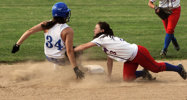 Danvers:<br /> Danvers' Devin Johnson is safe after running back to second during the Tewksbury at Danvers High softball state tournament game.<br /> Photo by Ken Yuszkus/Salem News, Thursday, May 31, 2012.