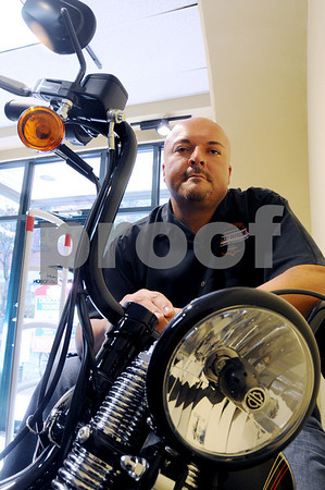 Salem:<br /> Michael Sienkiewicz, general manager of the Bruce Rossmeyer's Salem Harley-Davidson store that recently opened, sits on the Harley-Davidson motorcycle which is parked in the store. The store sells a variety of merchandise with the Harley-Davidson name.<br /> Photo by Ken Yuszkus/Salem News, October 7, 2008.