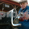 "Peabody:<br /> Billy Dunn shows the mailbox that he made from the original tail light and isignia from his classic 56 Chevy BelAir. The light goes on when the flag on the mailbox is raised. He also created a street sign that says, ""Chevy St."" for his driveway because of his love of Chevys. <br /> Photo by Ken Yuszkus/Salem News, Friday, March 20, 2009."
