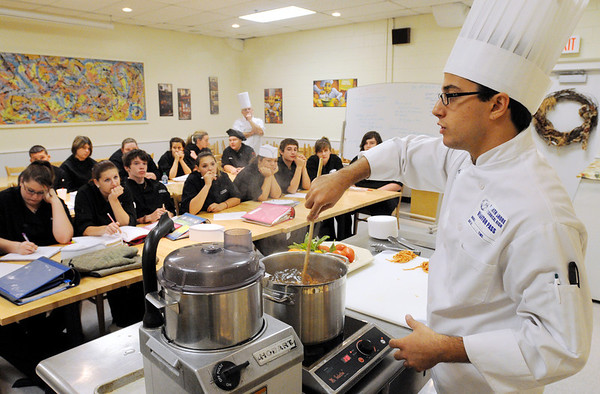 Middleton:<br /> Frankie King, student from the Culinary Institute of America, teaches gourmet cooking techniques to culinary arts students at the North Shore Technical High School on Tuesday.<br /> Photo by Ken Yuszkus/Salem News, Tuesday, October 18, 2011.
