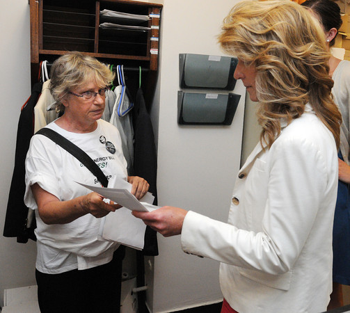 Salem:<br /> One of four protesters, Sue Kirby of Salem, left, presented two letters to Lynne Montague, chief of staff for Rep. John Keenan, in Rep. John Keenan's office in the statehouse after the rally in front of the statehouse.<br /> Photo by Ken Yuszkus/Salem News, Tuesday, July 17,  2012.