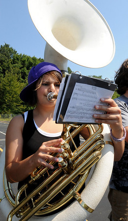 Beverly:<br /> Courtney Bennett, on sousaphone, plays music along with rest of the band during the Beverly High School band camp in the parking lot in back of the school.<br /> Photo by Ken Yuszkus/Salem News, Thursday,  August 19, 2010.