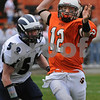 Beverly:<br /> Beverly's Mark Hannable throws the ball out of bounds just before Swampscott's Carl Zeller tackles him during the second quarter at the Swampscott at Beverly football game on Saturday.<br /> Photo by Ken Yuszkus/Salem News, Saturday, November 8, 2008.