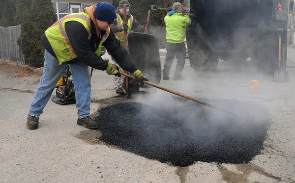 Beverly:<br /> From left, Paul Mancaniello, Renny Carroll, and Joe Egan, all from the Beverly highway department, repair a large pothole on Hobart Avenue.<br /> Photo by Ken Yuszkus/Salem News, Wednesday, March 9, 2011.