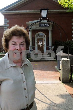 Ipswich:<br /> Marilyn Pauley, children's librarian, stands in front of the Public Library.<br /> Photo by Ken Yuszkus/Salem News, Wednesday, August 5, 2009.