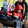 Beverly:<br /> Leah Rolph of Peabody, swings her children on a tire swing at Dane Street Beach. They are from left, twins, Micah and Anna, 2, and Jacob, 5. David, 7, was playing nearby. They are out enjoying the mild weather on the first day of December.<br /> Photo by Ken Yuszkus/Salem News, Thursday, December 1, 2011.